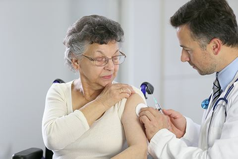 Woman about to receive a shot