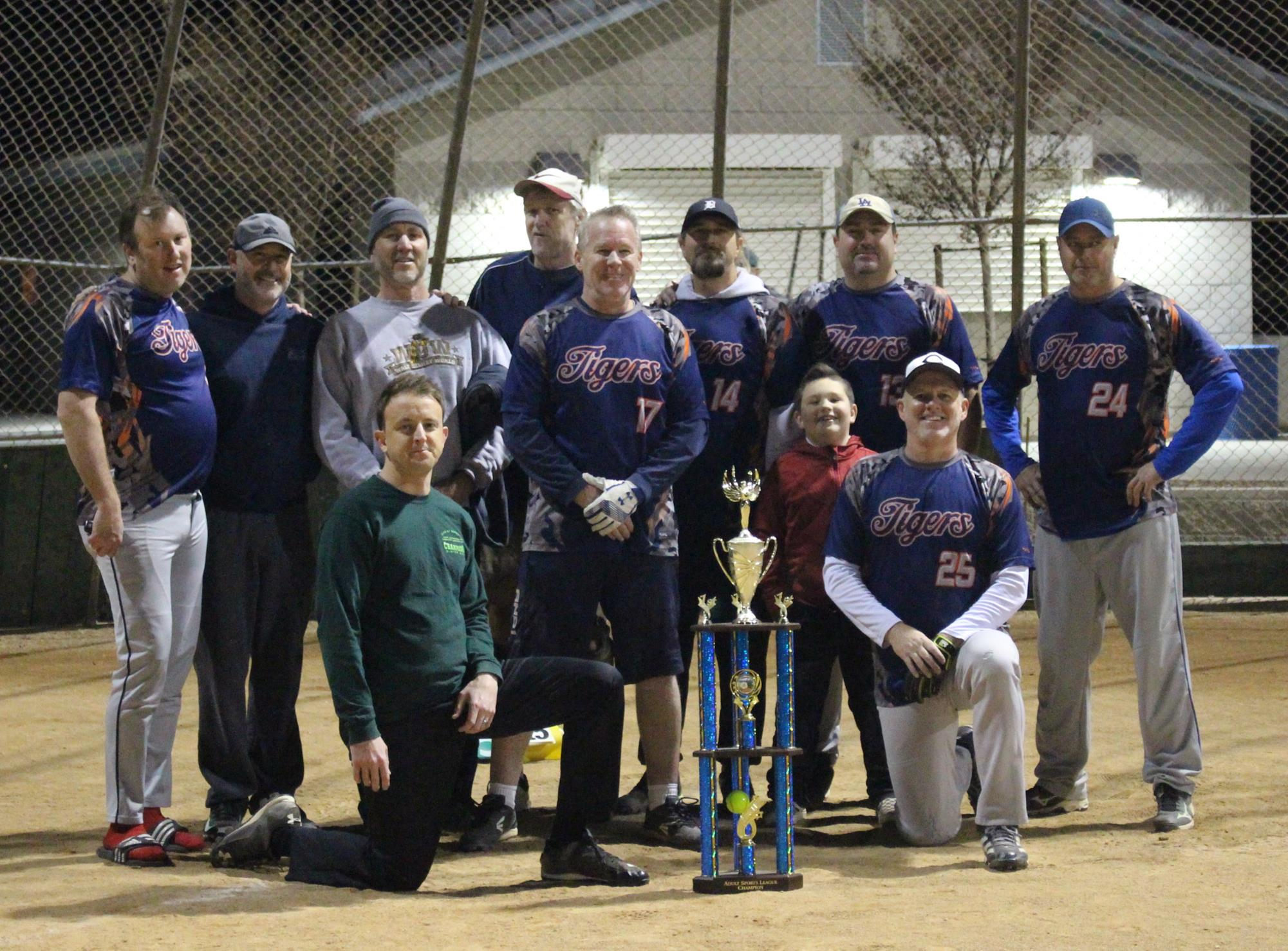 Adult softball team with trophy